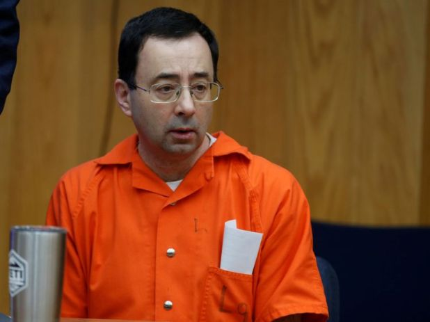 Larry Nassar sits in the courtroom as his third sentencing begins