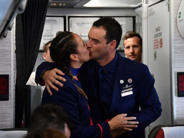 Paula Podest and Carlos Ciufffardi kiss after being married