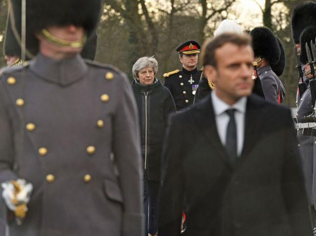 Theresa May and Emmanuel Macron view a guard of honour at the Royal Military Academy Sandhurst