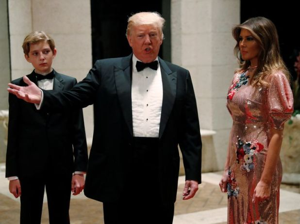 Donald Trump and first lady Melania Trump, with their son Barron, on New Year's Eve