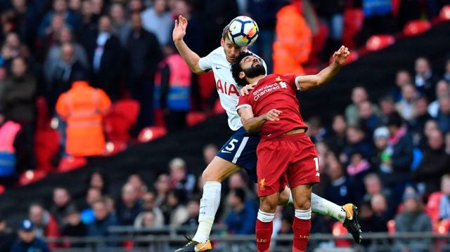 Tottenham Hotspur's Belgian defender Jan Vertonghen (L) vies with Liverpool's Egyptian midfielder Mohamed Salah during a Premier League football match