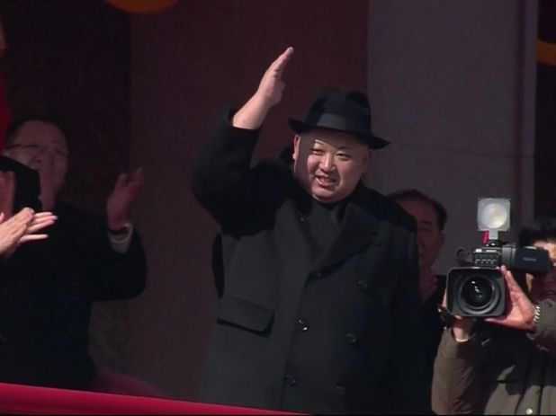 Km Jong Un salutes troops during a military parade in North Korea, flanked by his wife Ri Sol Ju