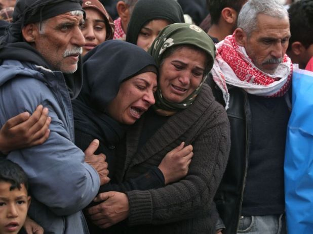 Syrian Kurds mourn in the northern town of Afrin during the funeral on February 1, 2018 of fighters from the People's Protection Units (YPG) militia and the Women's Protection Units (YPJ), killed in clashes in the Kurdish enclave in northern Syria on the border with Turkey