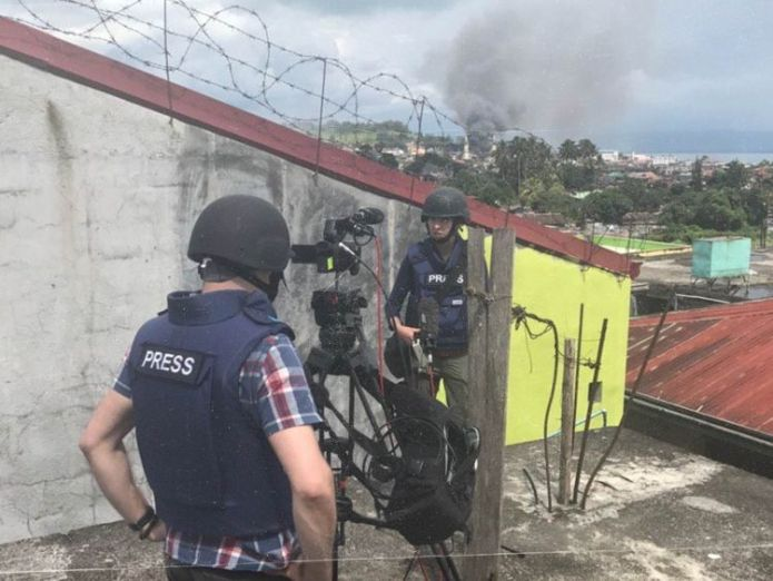 Katie and her team wearing helmets and bullet proof vests in Marawi Former Sky correspondent Katie Stallard-Blanchette on secretive states Former Sky correspondent Katie Stallard-Blanchette on secretive states skynews katie stallard hotspots 4230952