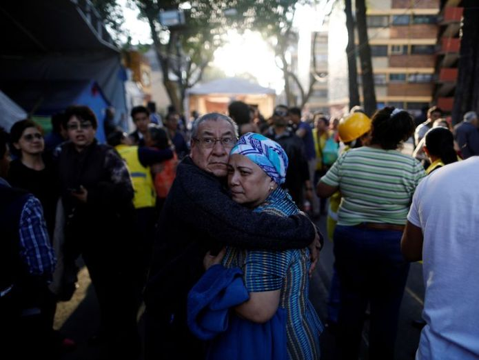 People react after an earthquake shook buildings in Mexico City, Mexico February 16, 2018 Mexican helicopter crashes near earthquake epicentre Mexican helicopter crashes near earthquake epicentre skynews mexico earthquake 4233323