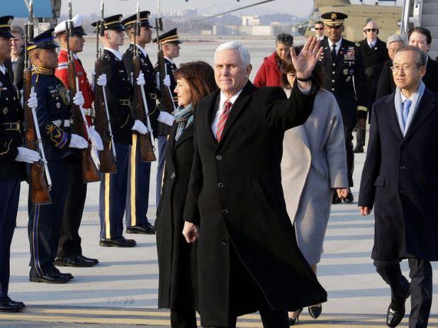 U.S. Vice President Mike Pence and his wife Karen arrive at Osan Air Base in Pyeongtaek, South Korea