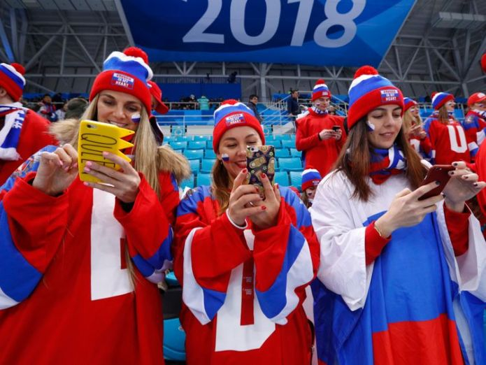 Ice Hockey - Pyeongchang 2018 Winter Olympics - Men's Quarterfinal Match - Olympic Athletes from Russia v Norway - Gangneung Hockey Centre, Gangneung, South Korea - February 21, 2018 - Russia fans check their phones before the game Olympians give dating app a boost at Winter Games Olympians give dating app a boost at Winter Games skynews russia pyeongchang 4239785