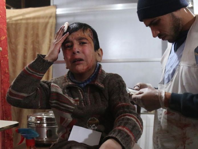 Ghaith, a wounded 12-year-old Syrian boy, cries as he receives treatment at a make-shift hospital in Kafr Batna and waits for news of his mother in the operating room UN calls for end to 'hell on earth' violence in eastern Ghouta UN calls for end to 'hell on earth' violence in eastern Ghouta skynews syria ghouta airstrike 4236568