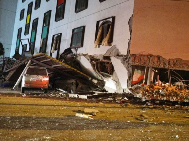 A damaged vehicle stands in rubble outside the Marshal Hotel in Hualien, eastern Taiwan early February 7, 2018, after a strong earthquake struck the island. A hotel on the east coast of Taiwan has collapsed after a 6.4-magnitude earthquake, the government said. / AFP PHOTO / PAUL YANG / Taiwan OUT (Photo credit should read PAUL YANG/AFP/Getty Images)