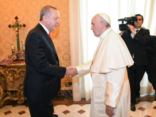 Pope Francis welcomes Turkish President Tayyip Erdogan during a private audience at the Vatican