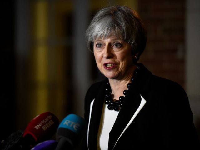 Theresa May speaks outside Stormont House, in Belfast