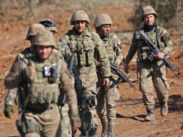 Turkish soldiers are deployed on Mount Bersaya, north of the Syrian town of Azaz near the border with Turkey, on January 29, 2018. Turkey launched operation 'Olive Branch' on January 20 against the Syrian Kurdish People's Protection Units (YPG) militia in Afrin, supporting Syrian opposition fighters with ground troops and air strikes