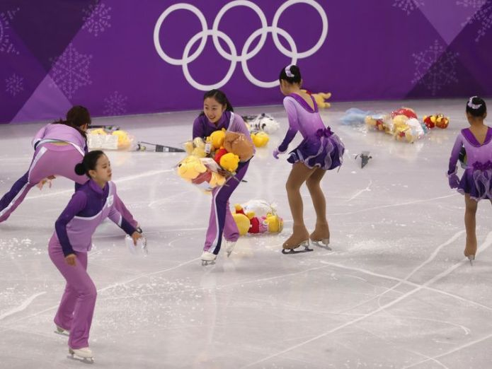Staff collected the toys after  Yuzuru Hanyu finished his routine Fanatic supporters shower Japanese figure skater Yuzuru Hanyu with Winnie the Pooh bears Fanatic supporters shower Japanese figure skater Yuzuru Hanyu with Winnie the Pooh bears skynews winter olympics winnie the pooh 4232743