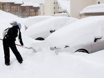 A woman removes the snow from her car in Saint-Chaffrey, France Ireland on red alert as 'extraordinary' storm approaches Ireland on red alert as 'extraordinary' storm approaches skynews europe snow france 4243815
