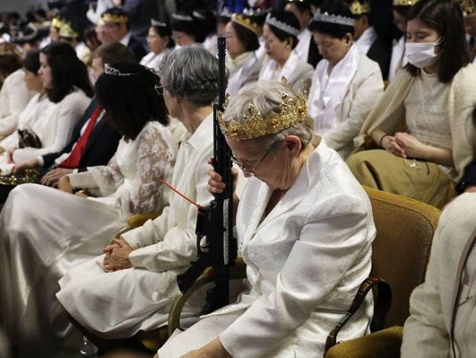Worshippers at World Peace and Unification Sanctuary hold weapons during their service Worshippers armed with AR-15s celebrate their marriages and weapons at a church in Pennsylvania Worshippers armed with AR-15s celebrate their marriages and weapons at a church in Pennsylvania guns church us sky news 4243548