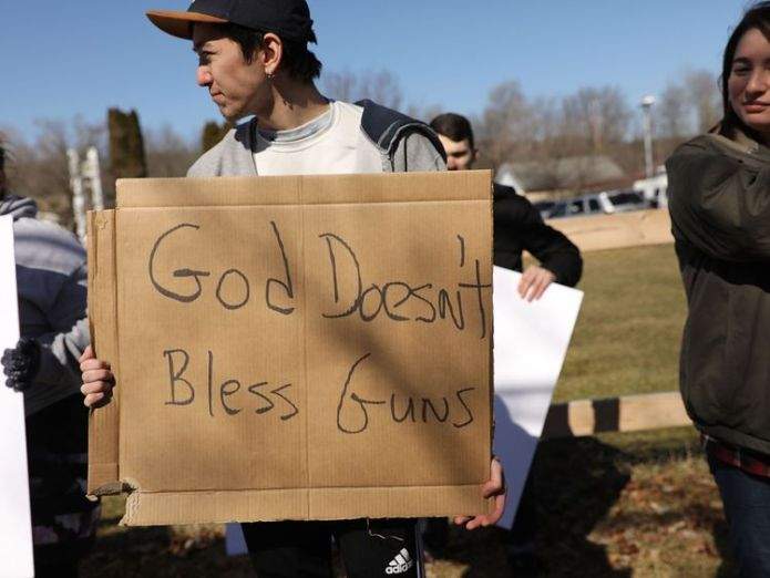 Anti-gun protesters outside the church Worshippers armed with AR-15s celebrate their marriages and weapons at a church in Pennsylvania Worshippers armed with AR-15s celebrate their marriages and weapons at a church in Pennsylvania guns church us sky news 4243560