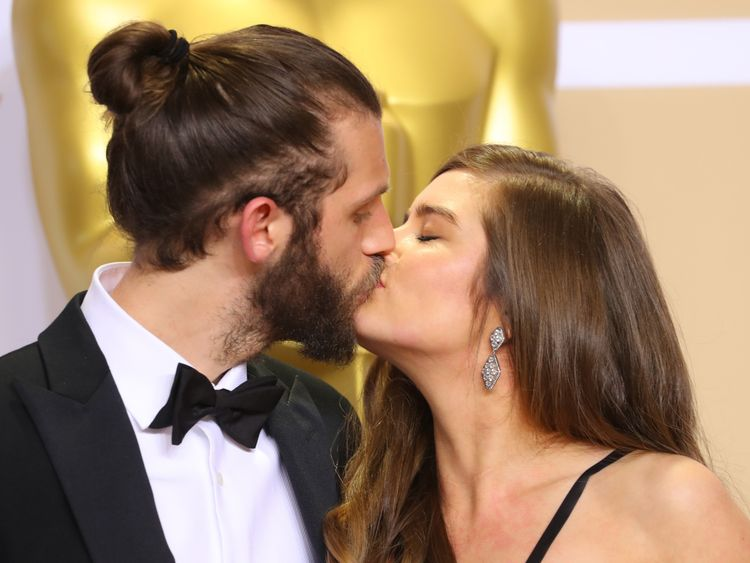 Chris Overton and Rachel Shenton kiss after winning the Oscar for the best live action short film