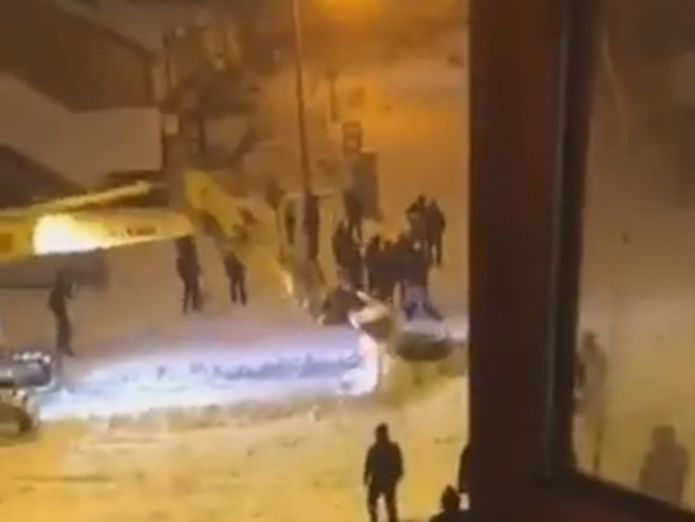 The digger was used to try and break open a safe retrieved from the store Nine held after gang attack Dublin Lidl with digger during Storm Emma Nine held after gang attack Dublin Lidl with digger during Storm Emma skynews lidl digger 4245180