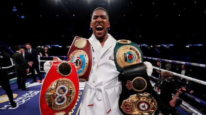 Anthony Joshua vs Joseph Parker - World Heavyweight Title Unification Fight - Principality Stadium, Cardiff, Britain - March 31, 2018 Anthony Joshua celebrates with the belts after winning the fight Stars recognised in Queen's birthday honours list Stars recognised in Queen's birthday honours list skynews anthony joshua boxing 4270349