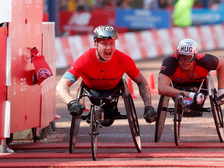 David Weir crosses the finish line on Sunday morning
