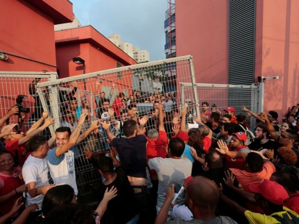 Supporters of the president reportedly tore down a fence