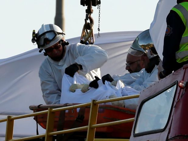 Rescue workers were seen lifting injured people off the bus with cranes