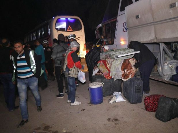 Syrian civilians and rebels evacuated from Eastern Ghouta on their way to Idlib