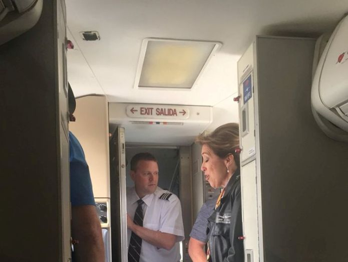 Pilot Tammie Jo Schults with members of the cabin crew on the plane in Philadelphia