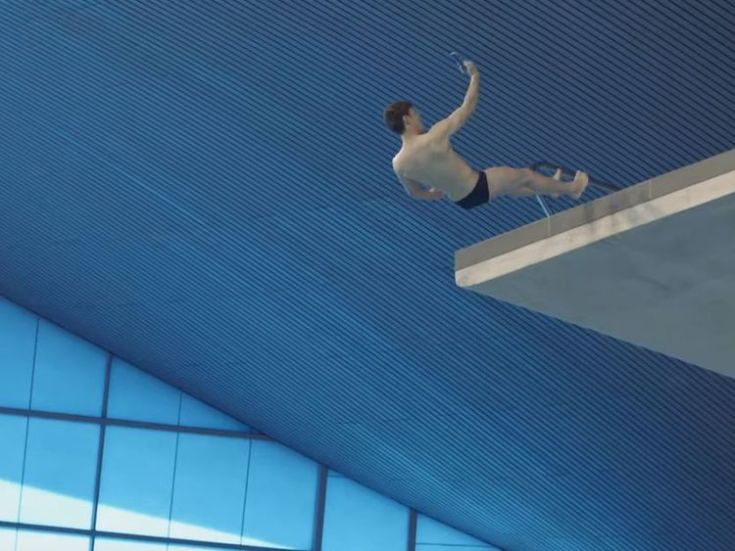 The Olympian dives off the high platform several times as he takes selfies. Pic: HTC