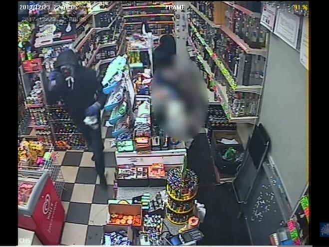 A robber flees from a shop in Twickenham after carrying out an attack