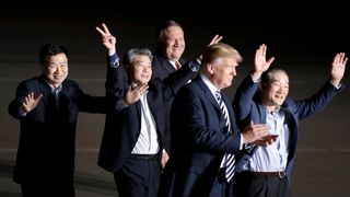 The three Americans formerly held hostage in North Korea gesture next to U.S.President Donald Trump and Secretary of State Mike Pompeo Donald Trump cancels summit with North Korean leader Kim Jong Un Donald Trump cancels summit with North Korean leader Kim Jong Un skynews donald trump prisoners hostages 4305462