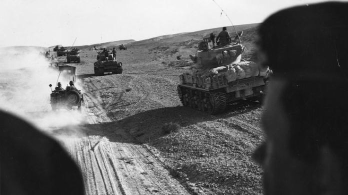 Israeli forces advancing in tanks in the Sinai Desert in 1967 during the Six Day War What is Nakba Day? What is Nakba Day? skynews six day war israel 4310691