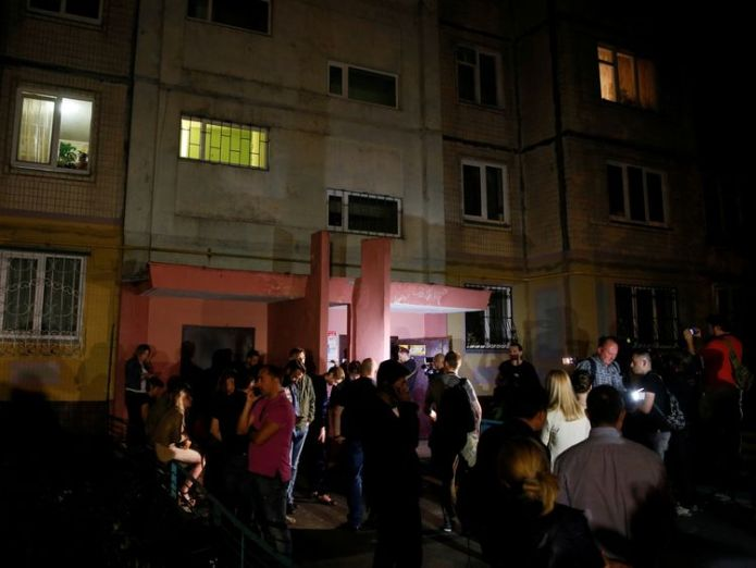 People gather outside the apartment building where Arkady Babchenko was shot  'dead' kremlin critic arkady babchenko appears at news conference 'Dead' Kremlin critic Arkady Babchenko appears at news conference skynews arkady babchenko journalist 4324001