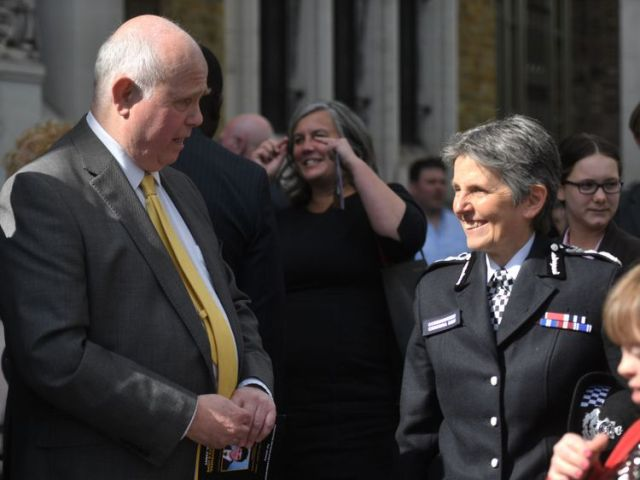 Barry Mizen talks to Cressida Dick after the tenth anniversary memorial service for Jimmy Mizen