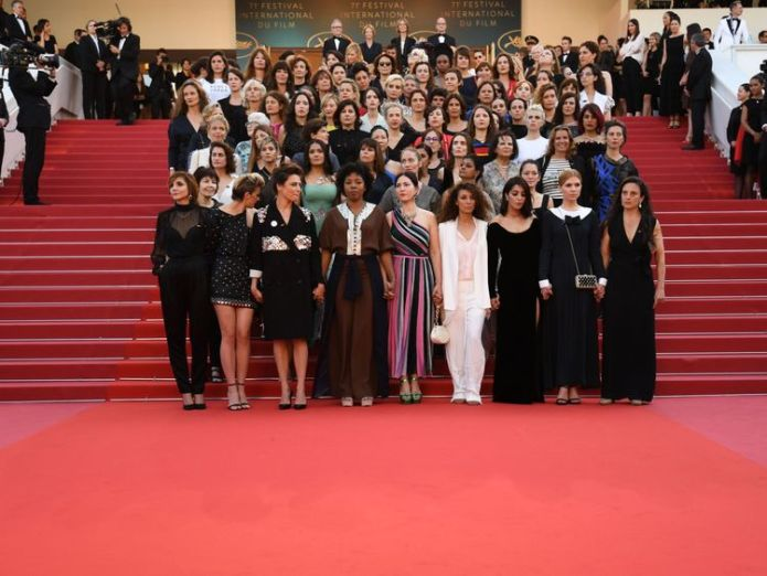 Directors, actresses and industry representatives pose on the red carpet in protest of the lack of female filmmakers honored throughout the history of the festival at the screening of 'Girls Of The Sun (Les Filles Du Soleil)' during the 71st annual Cannes Film Festival at the Palais des Festivals on May 12, 2018 in Cannes, southeastern France. - Only 82 films in competition in the official selection have been directed by women since the inception of the Cannes Film Festival whereas 1,645 films  Women protest on the red carpet at Cannes Women protest on the red carpet at Cannes skynews cannes film me too 4308242
