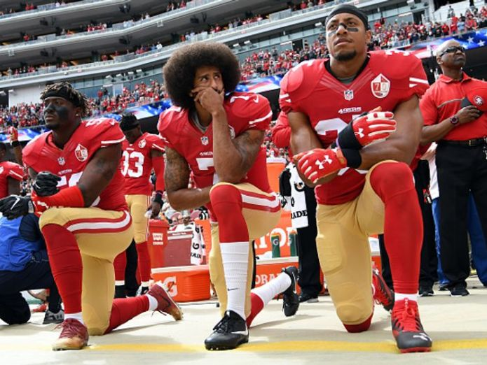 Colin Kaepernick, centre, started the kneeling protest movement in 2016 pre-season match Trump reignites NFL row by cancelling reception for Super Bowl champions Trump reignites NFL row by cancelling reception for Super Bowl champions skynews colin kaepernick nfl protest 4318535