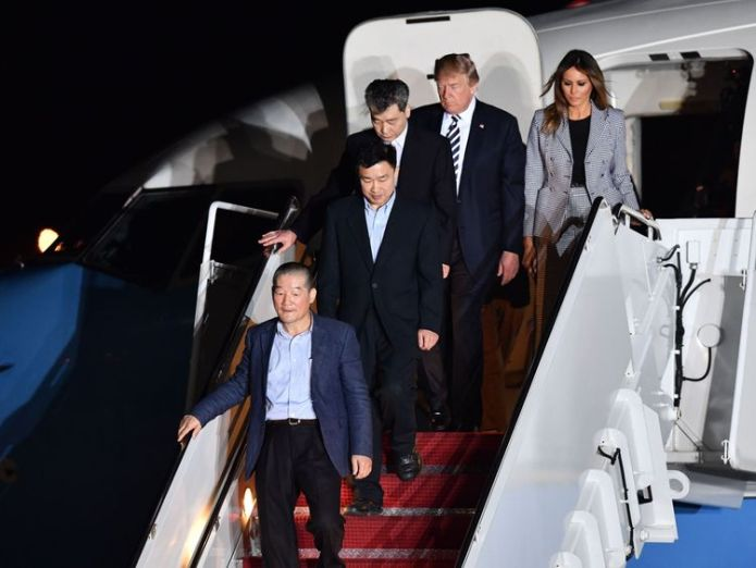 Donald Trump and his wife Melania walk down the stairs with US detainees 'Missing' Melania Trump to skip two key trips with president 'Missing' Melania Trump to skip two key trips with president skynews donald trump prisoners hostages 4305472