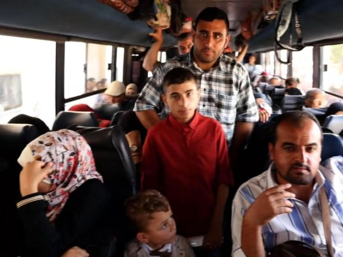 Palestinians on a bus to Egypt, after the border was opened as a rare gesture from Egypt The fight to leave the 'open air prison' of Gaza The fight to leave the 'open air prison' of Gaza skynews gaza palestinians 4315892