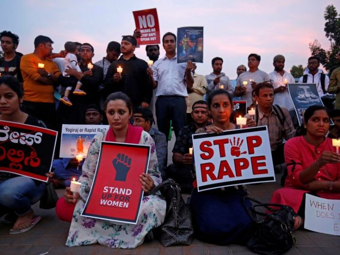 People participate in a candle light vigil as they protest against the rape of an eight-year-old girl in Kathua near Jammu, and a teenager in Unnao, Uttar Pradesh state, in Bengaluru, India, April 13, 2018. REUTERS/Abhishek N. Chinnappa/File Photo second teenage girl raped and set alight in india Second teenage girl raped and set alight in India skynews india rape world 4301595