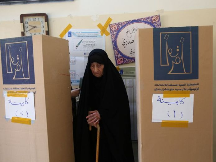 An Iraqi woman prepares herself to cast her vote at a polling station during the parliamentary election in Baghdad Controversial cleric emerges as likely winner in Iraq's national election Controversial cleric emerges as likely winner in Iraq's national election skynews iraq iraq elections 4307452
