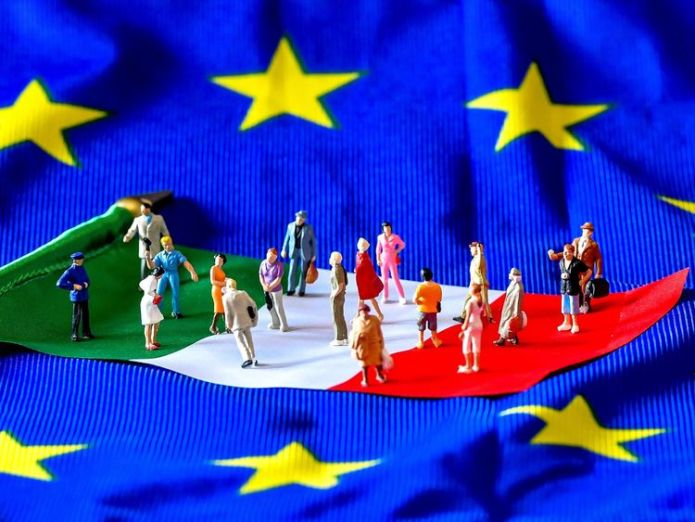 A picture taken on May 30, 2018 shows figurines on an Italian flag lying on a European Union flag Italy's markets recover amid calmer political waters Italy's markets recover amid calmer political waters skynews italy europe european union 4324280