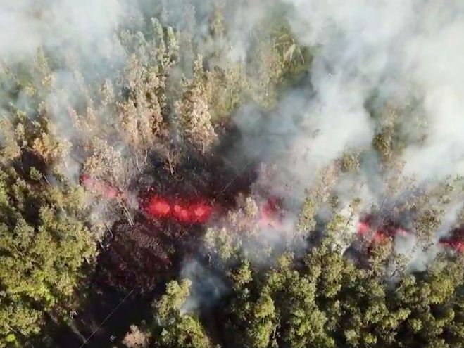 Lava emerges from the ground after Kilauea Volcano erupted, on Hawaii's Big Island. Pic: Jeremiah Osuna/via REUTERS