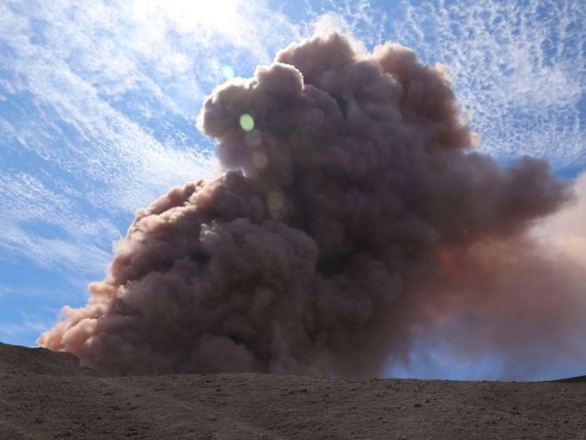 A plume of ash rises from the Puu Oo vent on Hawaii's Kilaueaa Volcano