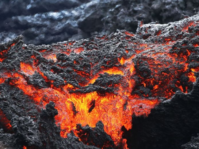 Lava flows at a lava fissure in the aftermath of eruptions from the Kilauea volcano on Hawaii's Big Island, on May 12, 2018 in Pahoa, Hawaii Major eruption of Hawaii's Kilauea is 'imminent' Major eruption of Hawaii's Kilauea is 'imminent' skynews lava volcano eruption 4311367