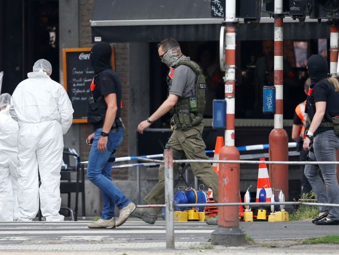 Forensics officers examine the scene in Liege prisoner kills two female officers with own guns in liege attack Prisoner kills two female officers with own guns in Liege attack skynews liege shooting terror 4323505