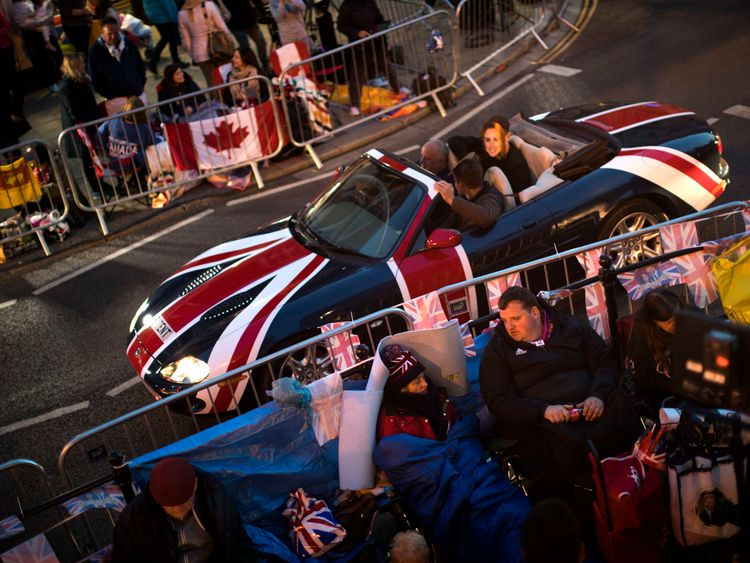 People begin sleeping out to get the best spots to get the best view of the royal couple
