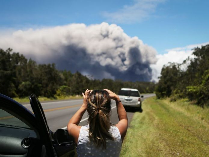 A massive plume of ash rises from the volcano Roads ripped up by rumbling Big Island Hawaii volcano Roads ripped up by rumbling Big Island Hawaii volcano skynews volcano hawaii kilauea 4312262