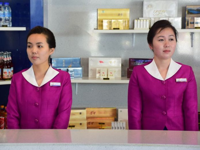 Two North Korean women at an airport kiosk in Wonsan. Pic: Michael Greenfield Fried turtle and constant monitoring Fried turtle and constant monitoring skynews wonsan north korea 4317177