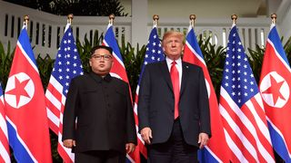 Messrs Trump and Kim pose at the first ever summit between sitting leaders of the US and North Korea   Satellite images show North Korea is 'dismantling facilities at ballistic missile site' skynews kim jong un donald trump 4334010