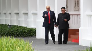 Donald Trump and Kim Jong Un during a break in their talks